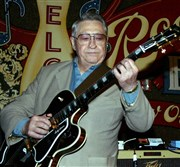 Scotty Moore, the pioneering rock guitarist whose sharp, graceful style helped Elvis Presley shape his revolutionary sound.
