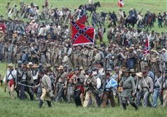 Confederate Civil War re-enactors march toward Union lines during Pickett's Charge on the last day of a Battle of Gettysburg re-enactment on June 30, 2013 in Gettysburg, Pa.