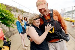 Joel Johnston, a teacher and volunteer trip leader for Venture Outdoors, hugs friend Anne Marie Fitzgerald of Brentwood, one of the several dozen people waiting for him at the Aspinwall Riverfront Park at the end of his 440-mile journey kayaking, backpacking and biking around Western Pennsylvania to raise money to buy adaptive paddling equipment for people with disabilities.