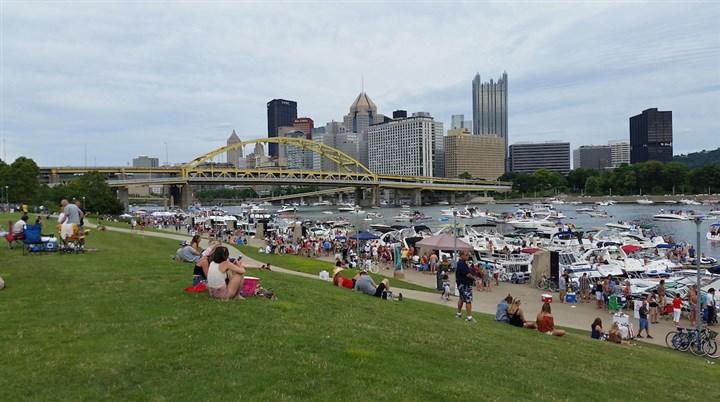 chesney concert boaters 07022016 Boaters and land-bound revelers take in Pittsburgh's skyline from the North Shore Saturday afternoon a few hours before Kenny Chesney's concert at Heinz Field.