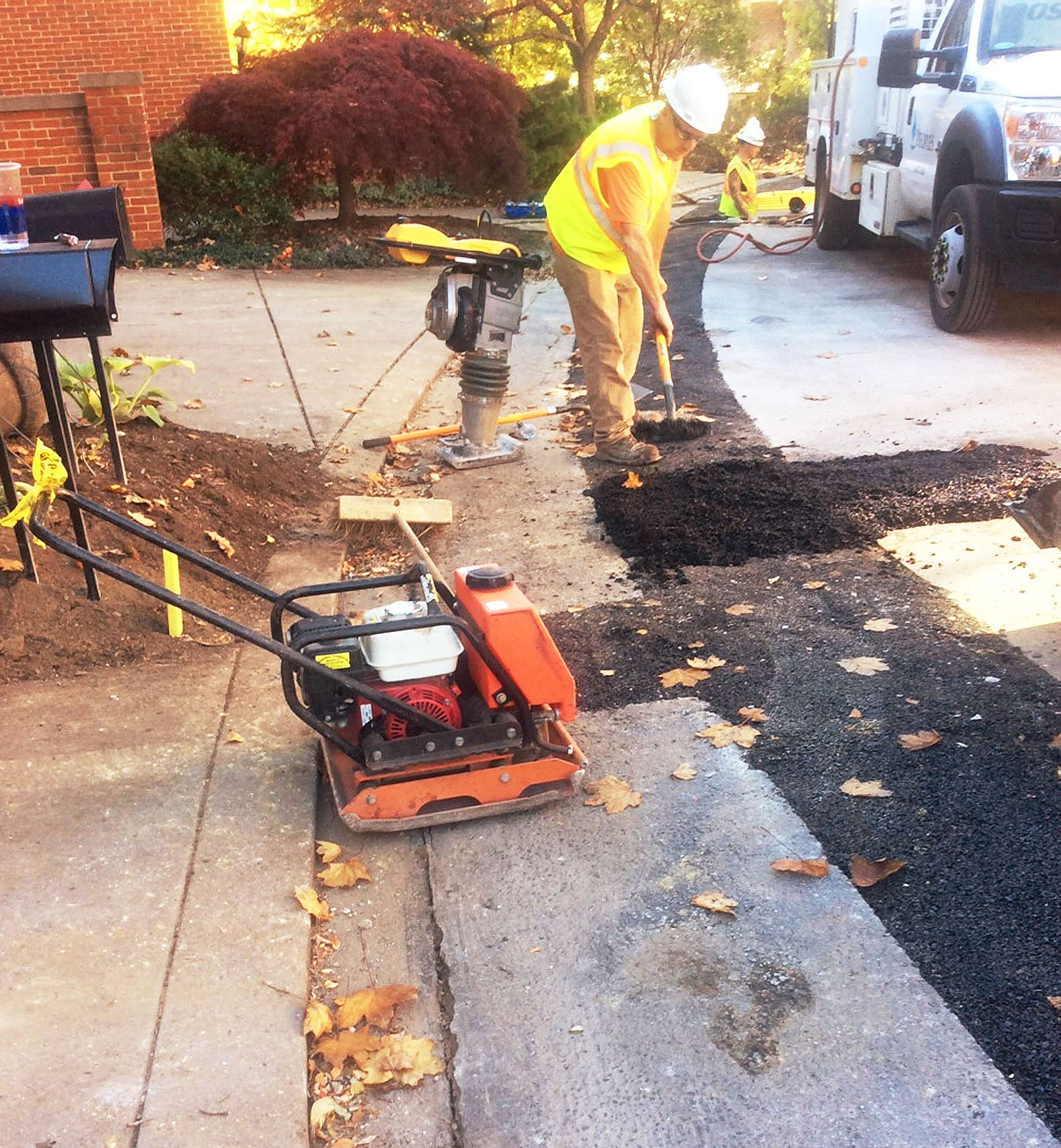 peoples_patch_sidewalk Peoples Natural Gas workers install a new gas line in Squirrel Hill.