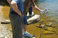 Senior Environment Corps volunteers check water quality samples from Sweet Arrow Lake in Schuylkill County.