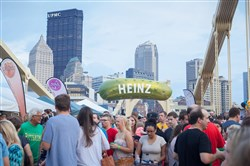 The Heinz Pickle balloon flies over the Rachel Carson Bridge in last year's Picklesburgh festival. The balloon was custom-built by a team that also crafts balloons for Disney and the Macy's Thanksgiving Day parade.  Picklesburgh will be held Friday and Saturday.