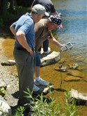 Senior Environment Corps volunteers Terry Boyer, left, and Joe Ryan check water quality samples from Sweet Arrow Lake in Schuylkill County.