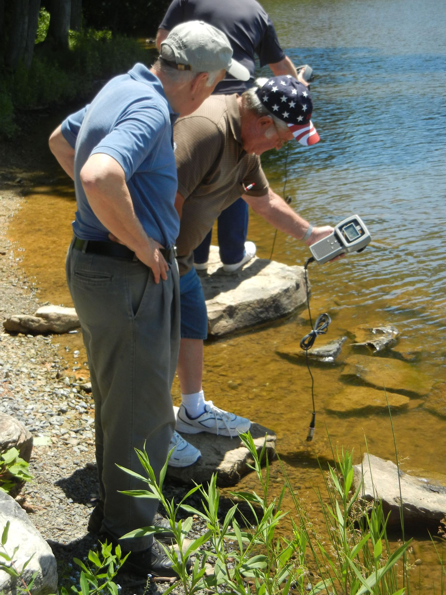 seniors0711_environment Senior Environment Corps volunteers Terry Boyer, left, and Joe Ryan check water quality samples from Sweet Arrow Lake in Schuylkill County.