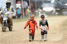 Keegan McDade, 5, right, walks with his friend Everett Rogan, 5, at the Bikes, Bands and BBQ fundraiser at the High Voltage MX Park in Ford City, Armstrong County, this month.