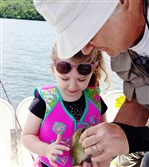 On July 2, Mia Jade Martinac, 4, of Tarentum caught her first fish at Lake Arthur, Butler County. She and the bluegill are pictured with her Pap Pap Mark Molnar of Saxonburg.