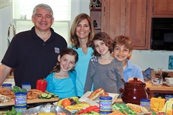 Neil Herlocher with his wife,Sharon and their children, from left, Phoebe, Laney and Charlie. Mr. Herlocher is the president of Herlocher Foods in State College.
