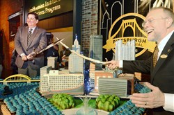 Mayor Bill Peduto and Andy Masich pose for a photo after cutting the birthday cake.