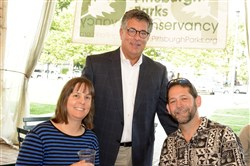 Sand City Spectacular VIP Reception: Sculptor Karen Fralich, left, and teammate Jon Woodworth, right, are welcomed to Pittsburgh by City of Pittsburgh chief operations officer Guy Costa.
