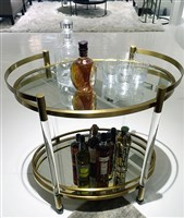 The Beverly bar cart by Mitchell Gold + Bob Williams employs acrylic, satin brass and mirrors to make a splash.