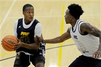 Then-Pitt basketball player Justice Kithcart is defended by Tarin Smith during a Pittsburgh Pro-Am Summer League game last July.