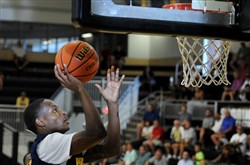Pitt basketball player Justice Kithcart makes a layup in a Pittsburgh Pro-Am Summer League game Monday at Montour High School.
