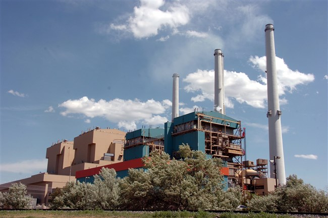 This 2010 photo shows the Colstrip Steam Electric Station, a coal-fired power plant in Colstrip, Mont. The Colstrip plant, a coal plant serving utility customers across the Pacific Northwest, has agreed to shut down two of its four units by 2022 under a settlement announced Tuesday, July 12, 2016, with environmentalists who sued over alleged air pollution violations.