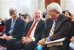 In this April 10, 2007 file photo, former House Speaker Newt Gingrich, right, and Sen. John Kerry, D-Mass., left, talk with former Indiana Rep. John Brademas on Capitol Hill in Washington prior to taking part in a debate on global warming. Mr. Brademas, the former president of New York University and a longtime Indiana congressman, has died at age 89.