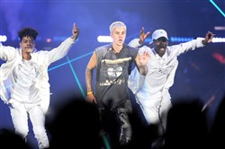 "Justin Bieber, center, performs at Consol Energy Center July 13 in his ""Purpose"" tour."
