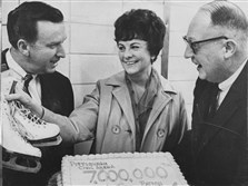 Penguins general manager Jack Riley, left, and Civic Arena executive director Charles Strong, right, congratulate Mrs. Robert Birkholz, the arena's 7,000,000th visitor, in February 1968.