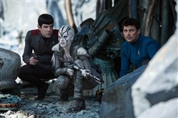 "In ""Star Trek Beyond,"" Zachary Quinto, left, plays Spock, Sofia Boutella is Jaylah and Karl Urban portrays Bones."