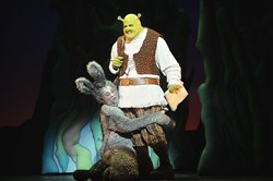 "Andre Jordan as Donkey and Rory Donovan as Shrek in Pittsburgh CLO's production of ""Shrek the Musical,"" at the Benedum Center through July 24."