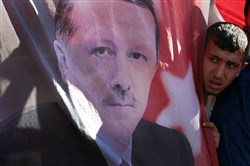 A portrait of Turkish President Recep Tayyip Erdogan displayed during a Saturday protest against the military coup outside Turkey's parliament near military headquarters in Ankara.