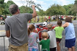 Spectators watch as the race cars go by on Sunday during the Group Four race of the Vintage Grand Prix.