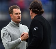 Henrik Stenson, left, shakes hands with Phil Mickelson after the pair finished 1-2 at the British Open Sunday in Troon, Scotland.