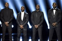NBA basketball players Carmelo Anthony, from left, Chris Paul, Dwyane Wade and LeBron James speak on stage at the ESPY Awards Wednesday in Los Angeles.