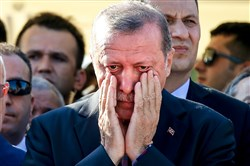 Turkish President Recep Tayyip Erdogan right, wipes his tears during the funeral of Mustafa Cambaz, Erol and Turkish President Recep Tayyip Erdogan wipes his tears Monday during the funeral in Istanbul for Mustafa Cambaz, and Erol and Abdullah Olcak, killed Friday while protesting the attempted coup against the nation's government.