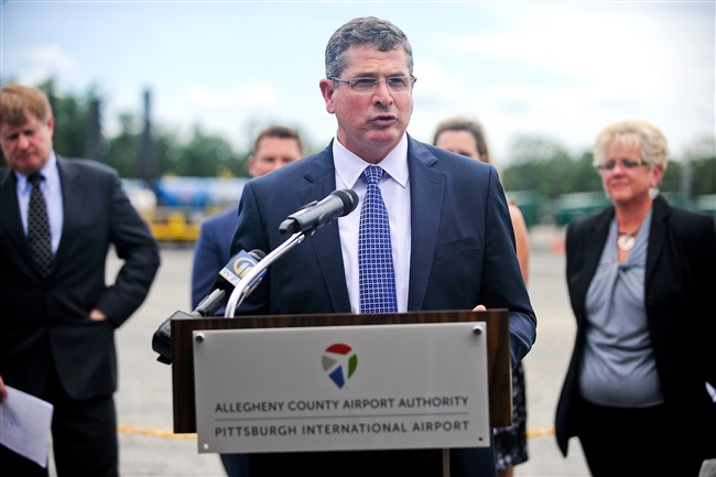 Tim Dugan, chief operating officer of Consol Energy, speaks at a press conference to mark initial production at the Pittsburgh International Airport natural gas development project.