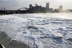 A thick layer of ice shrouds the North Shore of Pittsburgh during a January deep freeze. This winter broke records nationwide, as did the amount of natural gas used to heat homes and businesses.