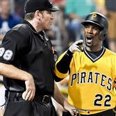Pirates center fielder Andrew McCutchen argues a called third strike with home-plate umpire Chris Conroy  earlier this season at PNC Park.