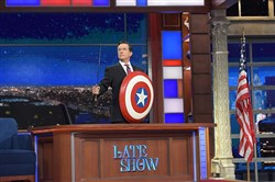 "The ""Colbert Report"" Stephen Colbert (with sword and shield) made a triumphant return to talk politics Monday night on CBS' ""The Late Show With Stephen Colbert."""