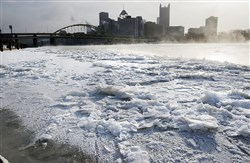 In this 2014 file photo, a layer of ice coats the North Shore looking toward Downtown Pittsburgh.
