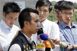 Kenneth Tong of the Hong Kong Immigration Center updates the media Tuesday in Wuerzburg, Germany, about the status of the Hong Kong Citizens who were injured in an attack on a regional train.