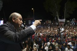 Turkey's President Recep Tayyip Erdogan addresses his supporters gathered in front of his residence in Istanbul on July 19.