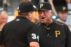 Clint Hurdle argues with home plate umpire Sam Holbrook Wednesday at PNC Park.