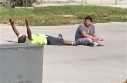 North Miami, July 18: Therapist Charles Kinsey, at left, was shot by police while trying to calm down his autistic patient, who had run away from an assisted living facility.