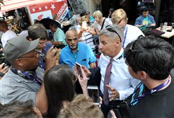 Gary Johnson, the Libertarian candidate for President, speaks to people gathered on E 4th Street in Cleveland, Ohio, during the Republican National Convention on Wednesday..