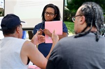 Tiffany Kinney of the Hill District leads a break-out session in June at the first meeting of a project to fight long-term trauma in the 2900 block of Webster Avenue.