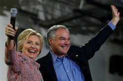 Democratic U.S. presidential candidate Hillary Clinton and U.S. Sen. Tim Kaine, D-Va., wave to the crowd during a campaign rally at Ernst Community Cultural Center in Annandale, Va., U.S., July 14.