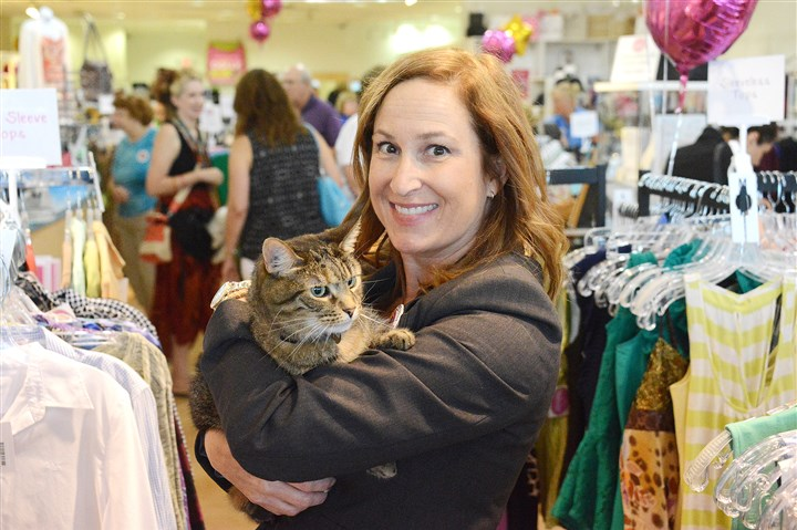 "20160722lf-Cat01 Nancy Lee with owner Dolly, whom she adopted from the Animal Rescue League. Dolly is the ""shop cat"" at WearWoof, Ms. Lee's upscale resale store where all proceeds go to local animal shelters, and a presidential candidate."