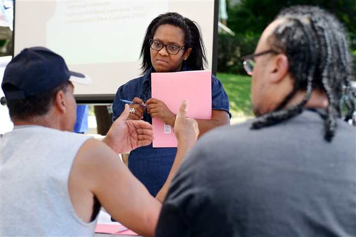 BULLDOG - 20160611ppFocus1LOC Tiffany Kinney of the Hill District leads a break-out session in June at the first meeting of a project to fight long-term trauma in the 2900 block of Webster Avenue.