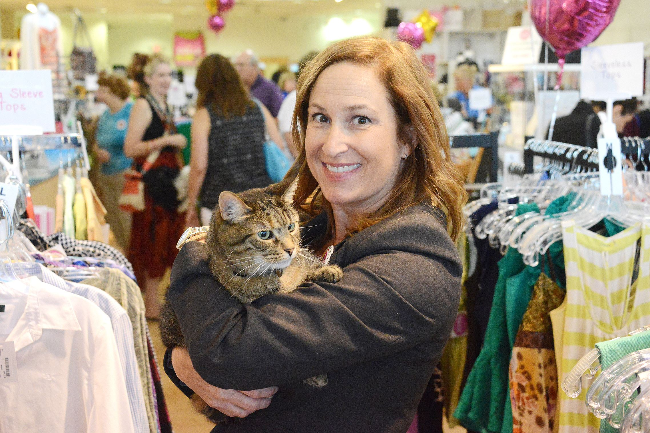 20160722lf-Cat01 Nancy Lee is closing WearWoof at the end of the month. Proceeds from the resale women's clothing shop go to animal welfare groups.