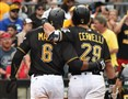 The Pirates' Starling Marte walks to the dugout with Francisco Cervelli after Cervelli hit sacrifice fly to score Marte on Saturday at PNC Park.