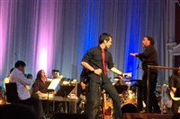 Brody Dolyniuk and conductor Brent Havens performing the Music of David Bowie with the Pittsburgh Symphony at Heinz Hall.