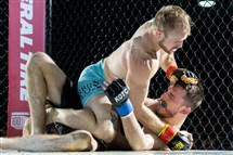 "Francis ""Mad Dog"" Healy battles Brett Ewing in an MMA fight Sept. 26, 2015 at The Meadows Racetrack and Casino."