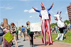Anti-fracking protesters march at Independence Hall in Philadelphia during a March for a Clean Energy Revolulion Sunday before the start of the Democratic National Convention.
