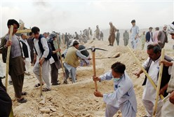 Afghan men dig graves for victims of a suicide attack Sunday in Kabul. The city was plunged into mourning after the deadliest attack for 15 years killed 80 people and left hundreds maimed, reigniting concern that the Islamic State group was seeking to expand its foothold in Afghanistan.