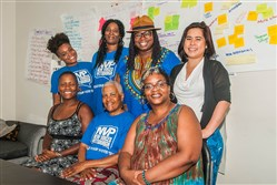 "Staffers for New Voices for Reproductive Justice, in the back row are Dom Steele, Simone Caldwell, La'Tasha Mayes, Ashley Chan. In the front row are Felicia Lane Savage, Lois ""Toni"" McClendon and  Carmen Alexander."