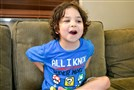 Laith Dougherty, 7, talks about video games Monday while at home.